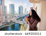 woman drinking tea in a luxury... | Shutterstock . vector #669203311