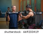 young personal trainer working... | Shutterstock . vector #669203419
