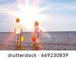 rear view of a brother and... | Shutterstock . vector #669230839