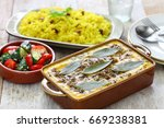 bobotie and yellow rice  south... | Shutterstock . vector #669238381