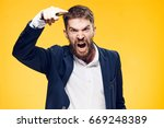 Small photo of Businessman with a beard on a yellow background, emotions, portrait, boss, anger, scream, aggression.