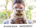 young woman holding cute... | Shutterstock . vector #669290947