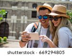happy couple looking at a photo ... | Shutterstock . vector #669294805