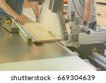 men at work sawing wood.... | Shutterstock . vector #669304639