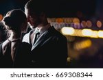 a couple in love stands against ... | Shutterstock . vector #669308344