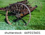 old iron plow used in the past... | Shutterstock . vector #669315601