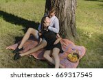 beautiful young couple sitting...   Shutterstock . vector #669317545