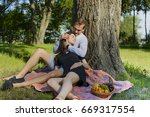 beautiful young couple sitting...   Shutterstock . vector #669317554