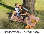 beautiful young couple sitting...   Shutterstock . vector #669317557