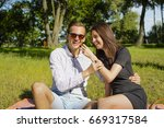 beautiful young couple sitting...   Shutterstock . vector #669317584