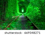 a railway in the spring forest... | Shutterstock . vector #669348271