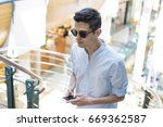 young man with mobile phone | Shutterstock . vector #669362587