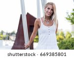 happy beautiful blonde woman... | Shutterstock . vector #669385801