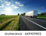red truck driving on asphalt... | Shutterstock . vector #669409801