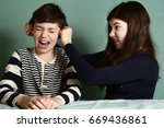 sister pull brother ear as a... | Shutterstock . vector #669436861
