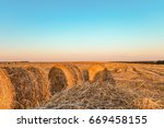 summer field with straw bales....   Shutterstock . vector #669458155