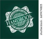 handbook written on a blackboard   Shutterstock .eps vector #669474805