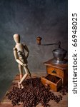 Still Life with Coffee grinder and jointed doll working the mill - stock photo