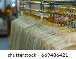 clothes hang on a shelf white... | Shutterstock . vector #669486421