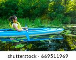 Woman Relaxing In The Kayak An...