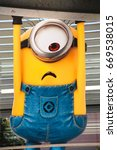 """Small photo of OSAKA, JAPAN - June 24, 2017 : Statue of """"HAPPY MINION"""", located in Universal Studios Japan, Osaka, Japan. Minions are famous character from Despicable Me animation."""
