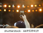 fan recording concert with... | Shutterstock . vector #669539419
