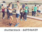 young men and women dancing a... | Shutterstock . vector #669546439