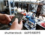 man holding a phone with a... | Shutterstock . vector #669548095