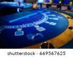 blurred gambling poker table  | Shutterstock . vector #669567625
