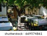 Small photo of Greek taverns town Afos, Hanioti, Kassandra, Greece 20 June 2017