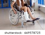 a young girl in a wheelchair is ... | Shutterstock . vector #669578725