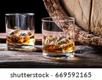 old and tasty cognac with ice... | Shutterstock . vector #669592165
