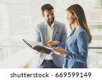business partners analyze the... | Shutterstock . vector #669599149