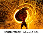fire dancers swing fire dancing ... | Shutterstock . vector #669615421