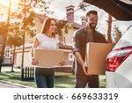 happy couple is standing near... | Shutterstock . vector #669633319