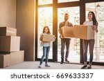 happy family with cardboard... | Shutterstock . vector #669633337
