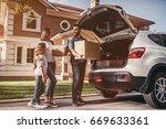 happy family is standing near... | Shutterstock . vector #669633361