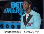 rapper gucci mane attends the... | Shutterstock . vector #669670744