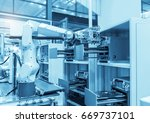 industrial robot with vacuum... | Shutterstock . vector #669737101
