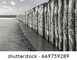 Beach Poles And Water Black An...
