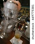 Small photo of preparation of traditional absinthe in bar on old town of prague