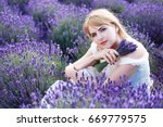 beautiful blond woman sitting... | Shutterstock . vector #669779575