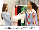 fashion boutique owner young... | Shutterstock . vector #669810457