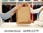 cropped shot of a shop... | Shutterstock . vector #669811279