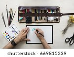 top view on calligrapher hands... | Shutterstock . vector #669815239