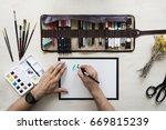 top view on calligrapher hands...   Shutterstock . vector #669815239