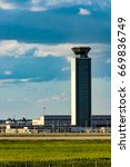 Small photo of Chicago, IL, United States: May 28, 2017: One of O'Hare Air Traffic Control Towers just before the sunset.