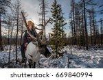 mongolian reindeer in... | Shutterstock . vector #669840994
