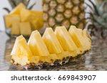ripe pineapple sliced on... | Shutterstock . vector #669843907