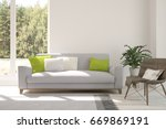 white room with sofa and green... | Shutterstock . vector #669869191